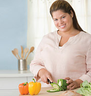 Image of young woman preparing healthy food